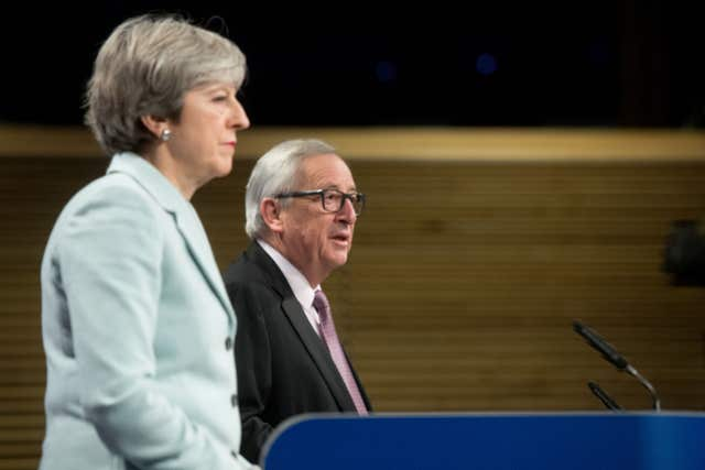 Theresa May will return to Brussels for further talks with European Commission president Jean-Claude Juncker next week (Etienne Ansotte/EU)