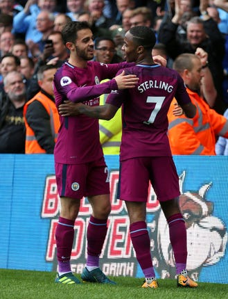 Raheem Sterling, right, has defended his team-mate