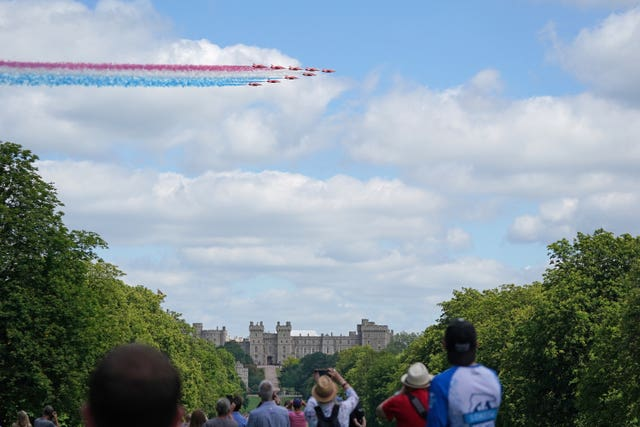 The Red Arrows fly over Windsor Castle to celebrate the Queen's official birthday