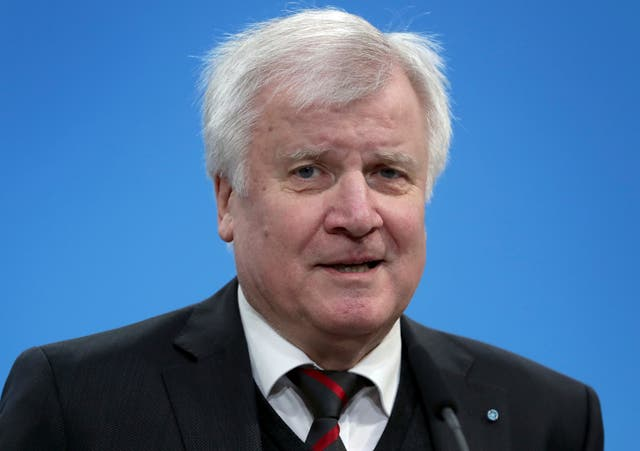 New German Interior Minister Horst Seehofer addresses the media in Berlin (AP Photo/Michael Sohn, file)