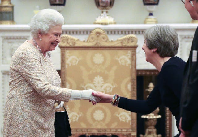The Queen greets Prime Minister Theresa May (Jonathan Brady/PA)