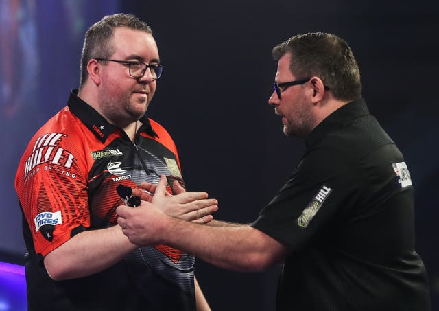 Stephen Bunting, left, had the last laugh after James Wade's nine-dart finish (Kieran Cleeves/PA)