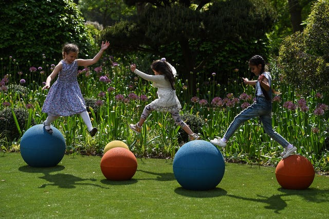 Children jumping between balls