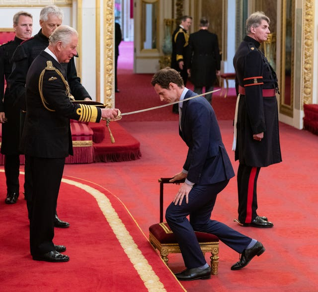 Andy Murray receives his knighthood from the Prince of Wales