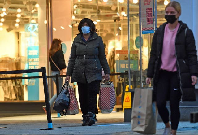 Shoppers leaving Primark in Birmingham (Jacob King/PA)