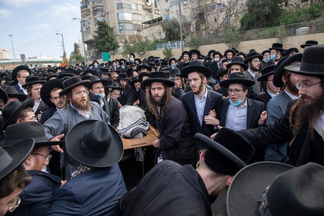 Attendees carry the body of Rabbi Meshulam Soloveitchik during his funeral in Jerusalem