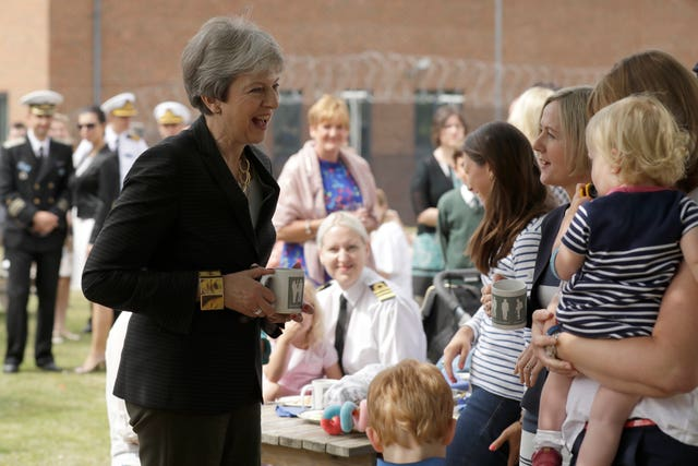 Theresa May meets armed forces personnel and their families at the Permanent Joint Headquarters and Nato's maritime headquarters in Northwood