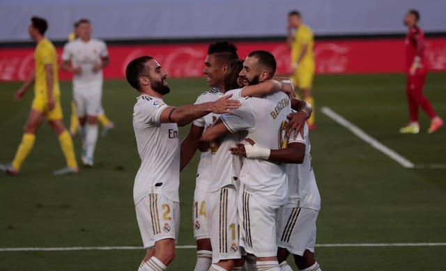 Real Madrid's Karim Benzema (right) celebrates after scoring against Villarreal