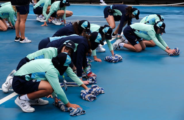 Ball boys and girls mopped the courts with towels