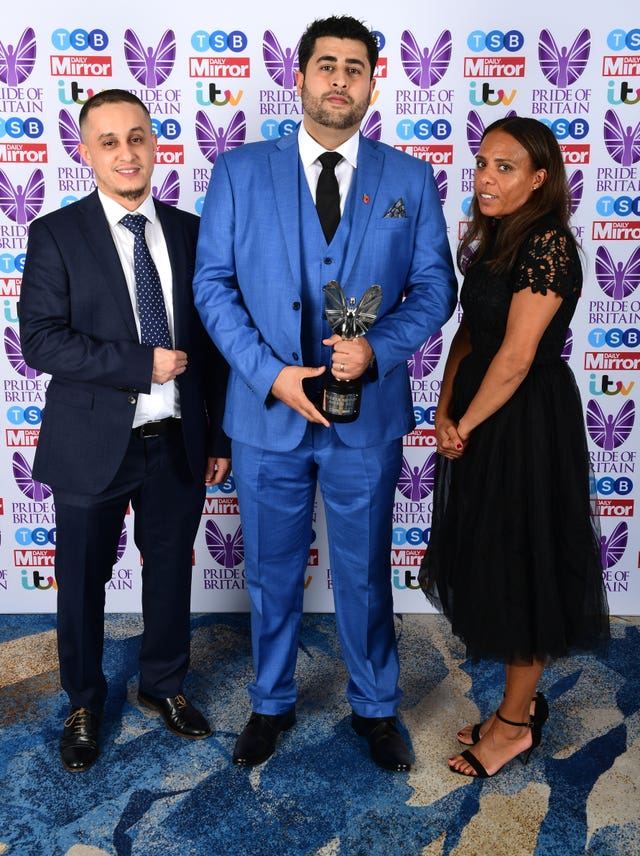 Shahin Sadafi (centre) with members of the Grenfell community Bellal Elguenuni and Natasha Ellcock at the Pride of Britain Awards 2017 in October (PA Wire / Ian West)