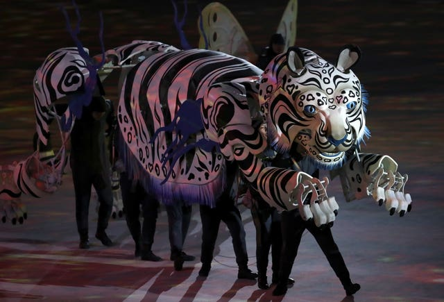 Performers in a tiger costume during the opening ceremony at the 2018 Winter Olympics in Pyeongchang