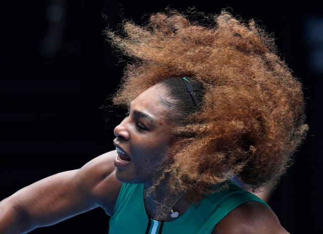 Serena Williams' hair flies around her during a comprehensive win over Tatjana Maria