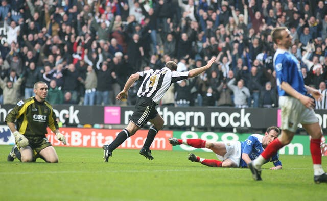 Alan Shearer celebrates after scoring his 201st goal for Newcastle to break Jackie Milburn's record
