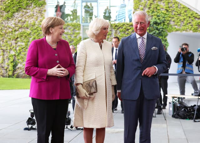 Charles and Camilla meet German Chancellor Angela Merkel during a previous visit to Germany in 2019. Steve Parsons/PA Wire