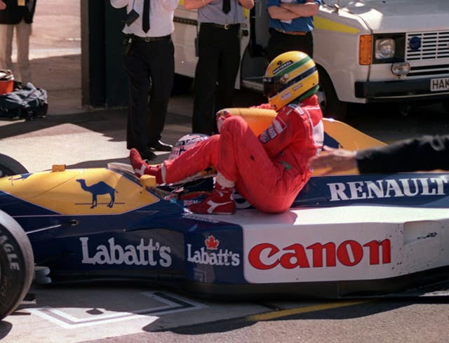 Ayrton Senna hitches a ride on Nigel Mansell's Williams Renualt after he ran out of fuel on the last lap of the British Grand Prix at Silverstone