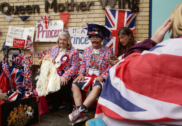 Royal fans Margaret Tyler and Terry Hutt waiting outside the hospital for the birth of Princess Charlotte in 2015 (Yui Mok/PA)