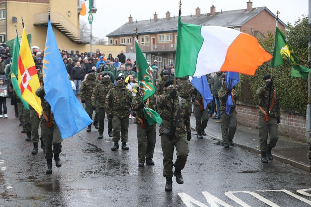 A Republican colour party during their Easter Commemoration parade in the Creggan area of Derry (Niall Carson/PA)