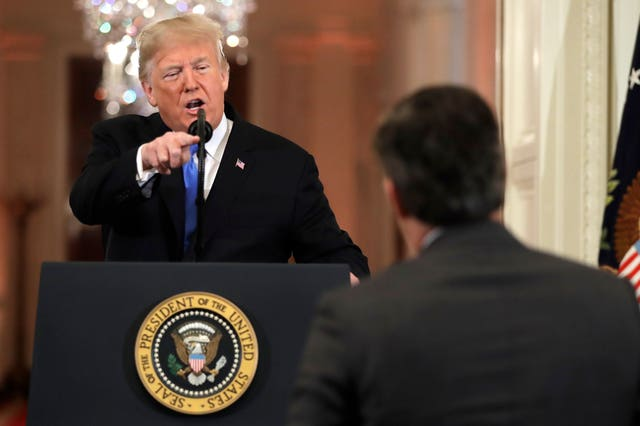 Donald Trump points at CNN's Jim Acosta