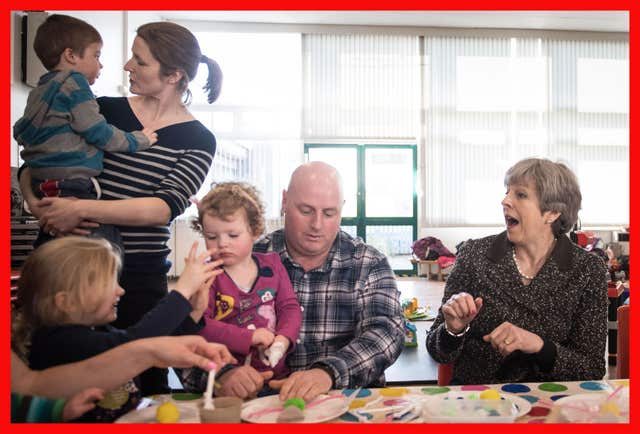 Prime Minister Theresa May joins in the fun with  a parent and toddler group at St Andrew's Heddon-on-the-Wall, CofE Primary School in Newcastle (Stefan Rousseau/PA)