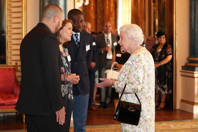 The Queen speaks with Dai Hankey, Dr. Rose Drew, and Pastor Kingsley Avanagh (Jonathan Brady/PA)