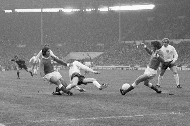 Bell, centre, is closed down by West Germany's Gerd Muller, left, and Paul Breitner, right, in England's defeat at the 1972 European Championship