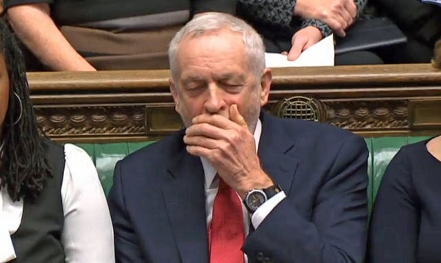 Labour party leader Jeremy Corbyn pretends to yawn during Prime Minister's Questions in the House of Commons