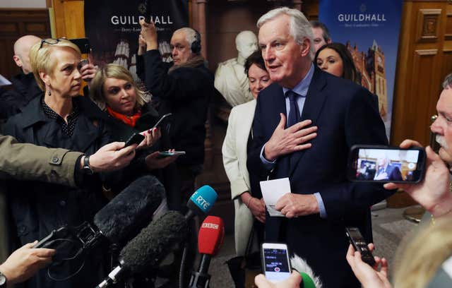 Mr Barnier arrives to meet business stakeholders and cross-border groups at the Guildhall in Derry (Niall Carson/PA)