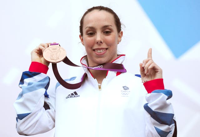 Beth Tweddle shows off her bronze medal won in the women's uneven bars in 2012