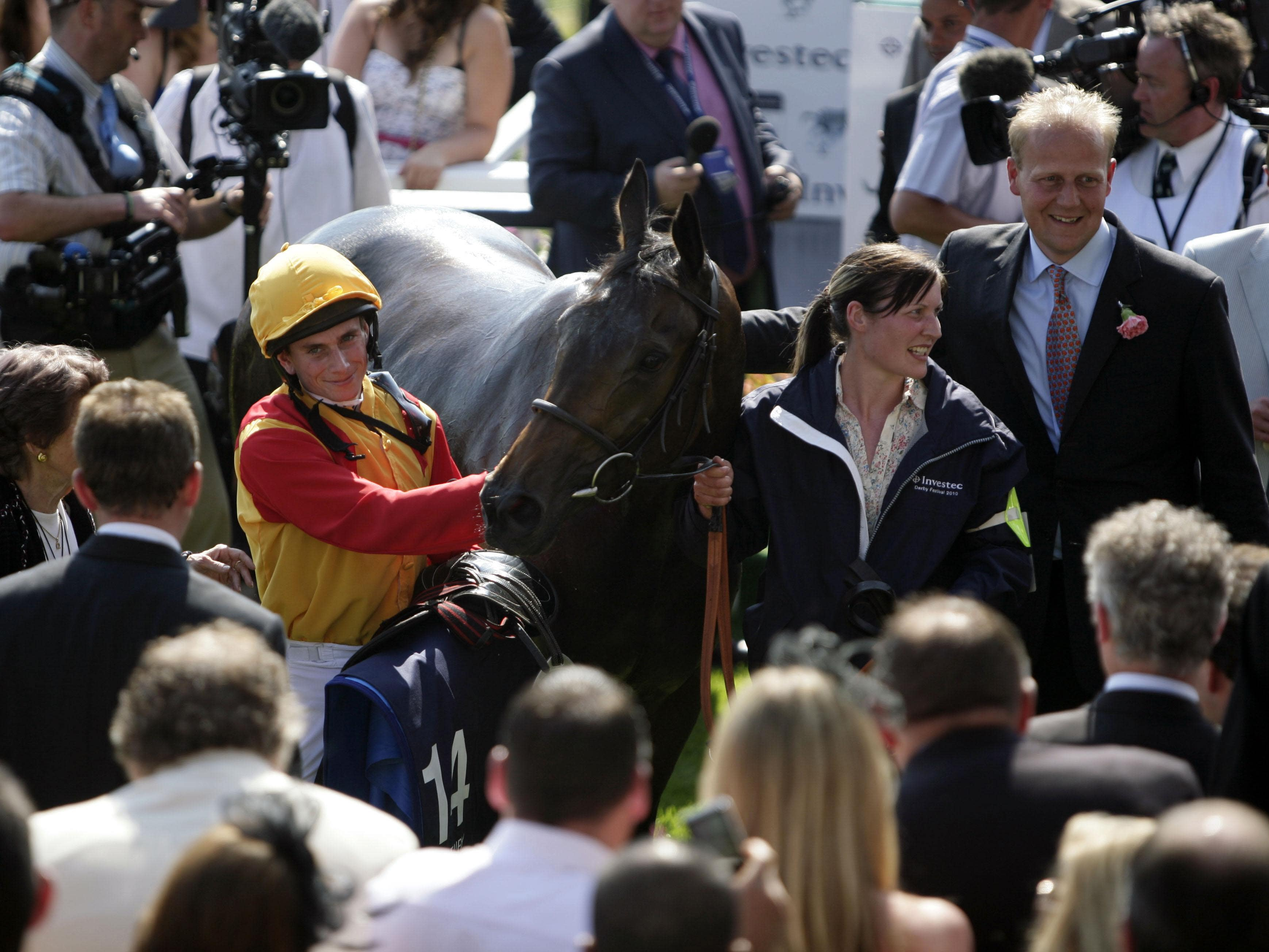 Ed Dunlop (right) with Snow Fairy, John Leeper's dam, after her Oaks win (Steve Parsons/PA)