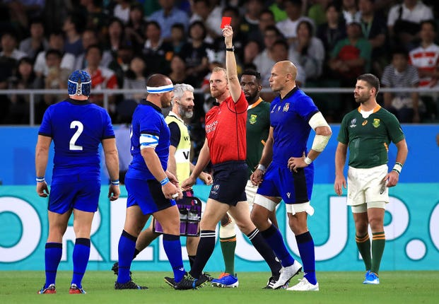 Referee Wayne Barnes, centre, shows a red card to Italy's Andrea Lovotti, second left
