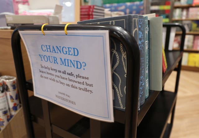 A trolley for books that have been browsed but not purchased by customers in a London branch of Waterstones