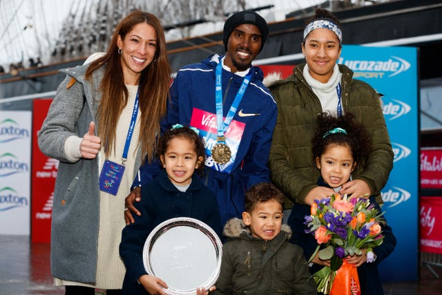 Mo Farah celebrated with his wife Tania (left) daughter Rihanna (right) twins Aisha and Aman and son Hussein after winning the Vitality Big Half in London on Sunday (John Walton/PA).