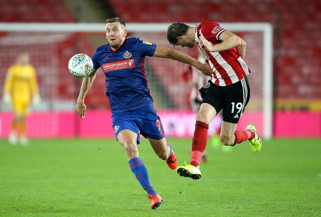 Charlie Wyke and Sheffield United's Richard Stearman battle for the ball