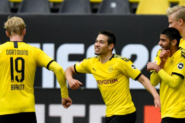 Dortmund's Raphael Guerreiro celebrates with Julian Brandt after scoring his side's second goal