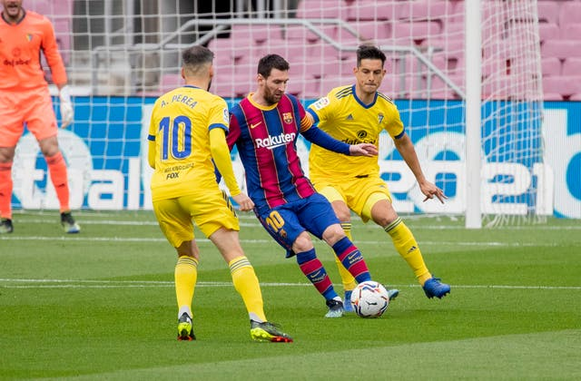 Barcelona's Lionel Messi (centre) made a record 506th LaLiga appearance for the club against Cadiz