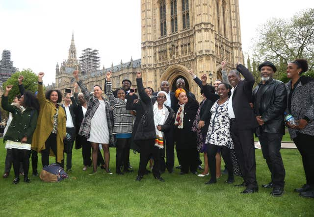 David Lammy MP (centre, back row) with members of the Windrush generation (Yui Mok/PA)