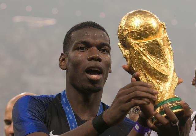 France's Paul Pogba celebrates with the World Cup won in Russia this summer
