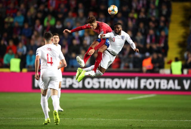 Danny Rose, right, challenges Patrik Schick for a high ball