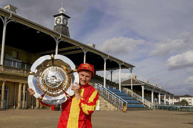 Tom Marquand with the St Leger trophy