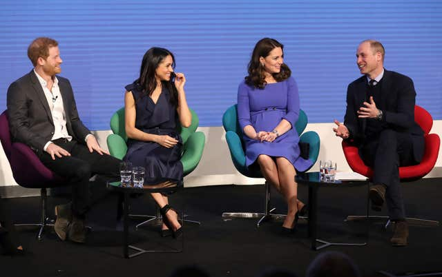 Harry, Meghan Markle, Kate and William on stage (Chris Jackson/PA)