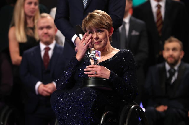Tanni Grey-Thompson wipes away a tear after winning the Lifetime Achievement award during the BBC Sports Personality of the Year ceremony