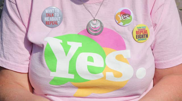 Yes badges on the T-Shirt of Liz Crummie, as the result is announced at Dublin Castle (Niall Carson/PA)