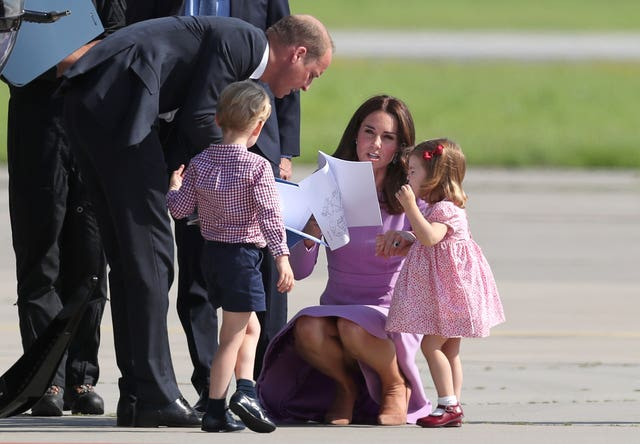 The Duke and Duchess of Cambridge, with their children Prince George and Princess Charlotte (Jane Barlow/PA)