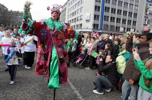 Performers take part in the annual St Patrick's Day parade in Belfast