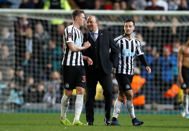 Sean Longstaff with Newcastle manager Rafael Benitez.