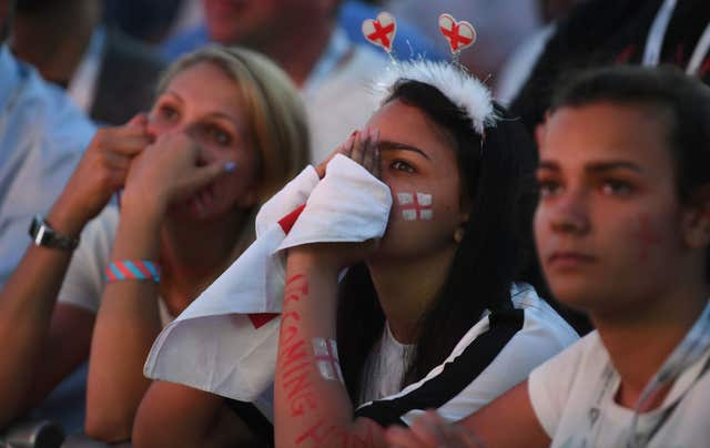 England supporters look on in anguish in Hyde Park as England suffer semi-final defeat