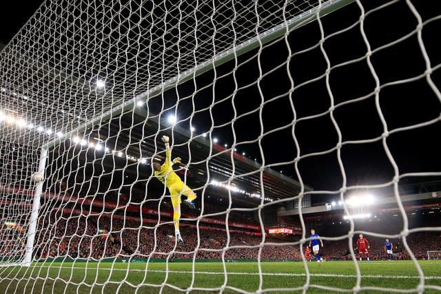 Everton goalkeeper Jordan Pickford is beaten by Curtis Jones' shot in Liverpool's 1-0 FA Cup win