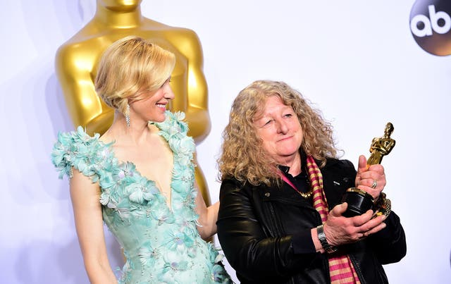 Cate Blanchett presenting Jenny Beavan with the Academy Award for Best Costume Design