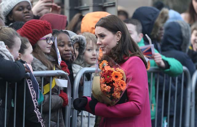 Kate was handed flowers on her arrival