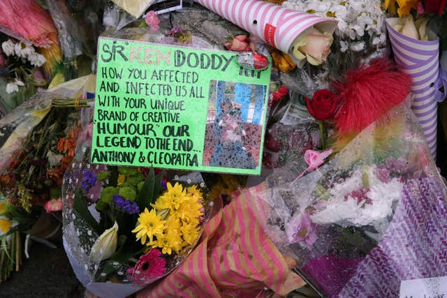 Floral tributes outside the home of Sir Ken Dodd in Knotty Ash (Aaron Chown/PA)